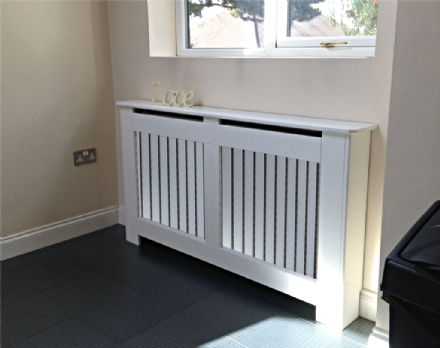 Satin white modern  radiator cover with a horizontal or vertical grille.